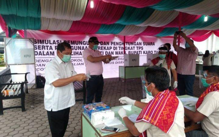 Pilkada di Karo Sukses, Pemilih dan Petugas KPPS Pakai Masker dan Sarung Tangan